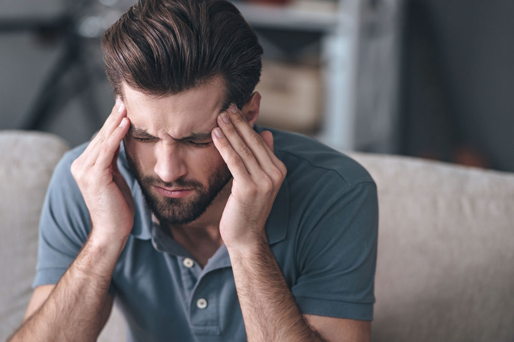 Man with chronic headaches needs to seek a chiropractor in Savannah, GA